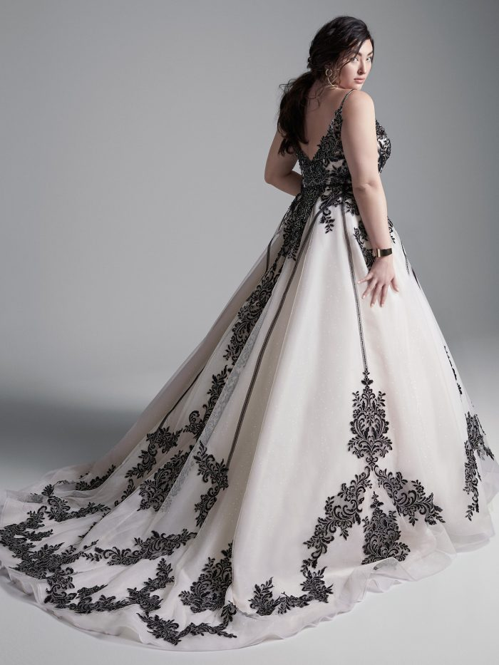 Plus Size Model Wearing Plus Size Black Lace Wedding Dress Called Santiago by Sottero and Midgley