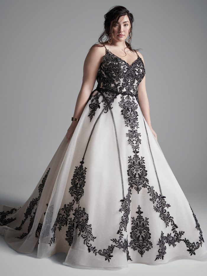 Curvy Model Wearing Plus Size Black Lace Wedding Dress Called Santiago by Sottero and Midgley