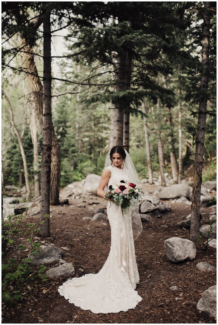 Real Bride Wearing Modest Sheath Wedding Dress Called Suzanne Rose by Sottero and Midgley in Forest