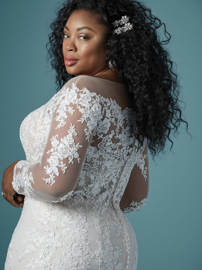 Curvy Black Model Wearing Plus Size Off the Shoulder Lace Wedding Gown Called Chevelle Lynette by Maggie Sottero
