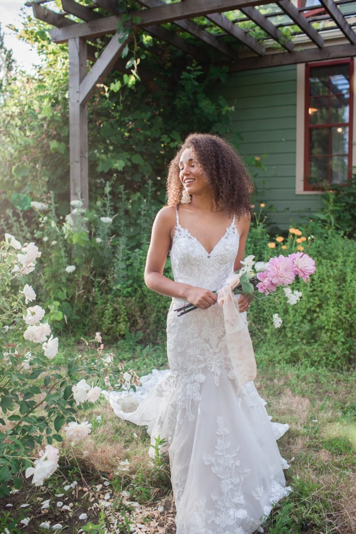 Black Bride Wearing Nature-inspired Mermaid Wedding Dress Called Giana by Maggie Sottero
