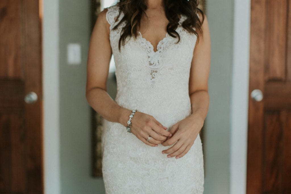 Bride Wearing Lace Sheath Wedding Dress Called Hope by Rebecca Ingram