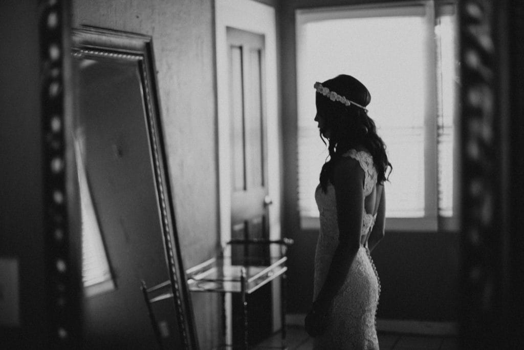 Black and White Image of Bride Looking in Mirror on Wedding Day