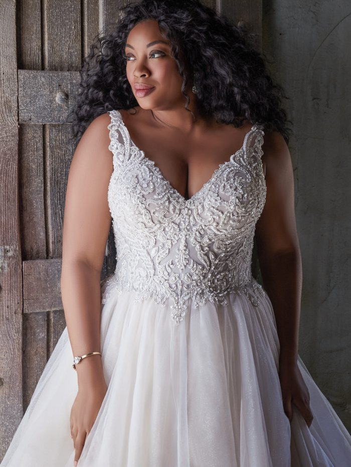 Model Wearing Plus Size Sparkly Wedding Gown Called Taylor Lynette by Maggie Sottero
