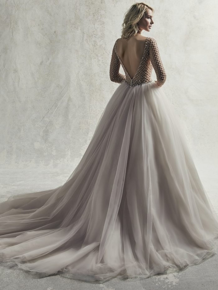 Model Wearing Long Sleeve Beaded Ball Gown Wedding Dress Called Fitzgerald by Sottero and Midgley