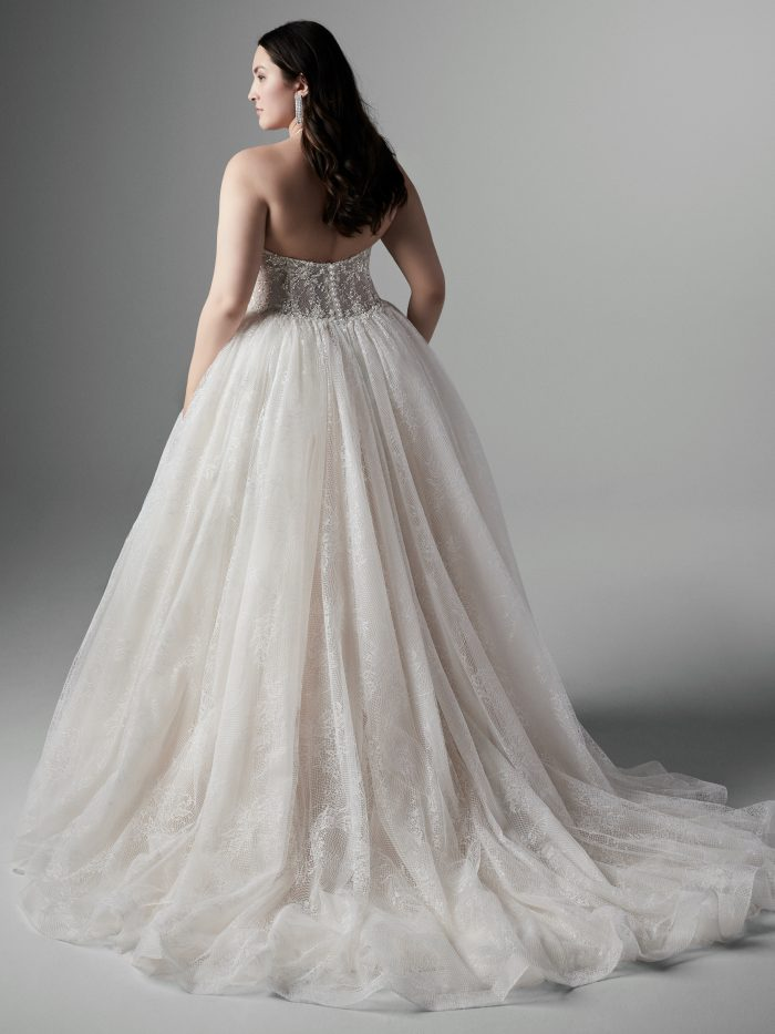 Plus Size Model Wearing Halter Neck Ballgown Wedding Dress Called Thaddeus by Sottero and Midgley
