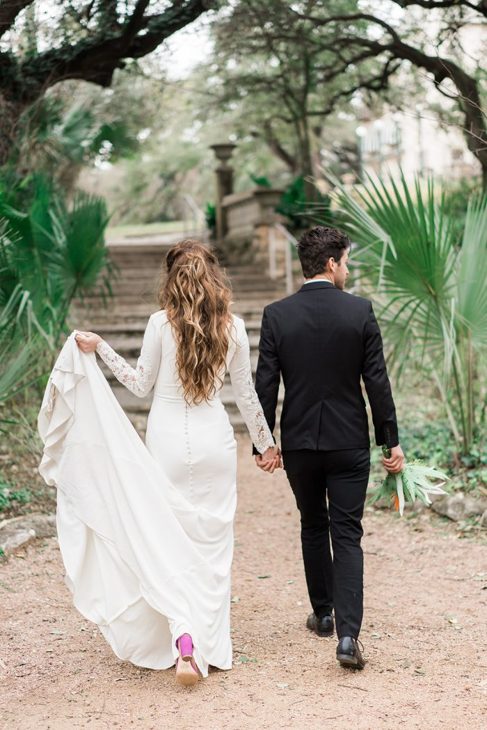 A photo of a bride and groom at a tropical style wedding.
