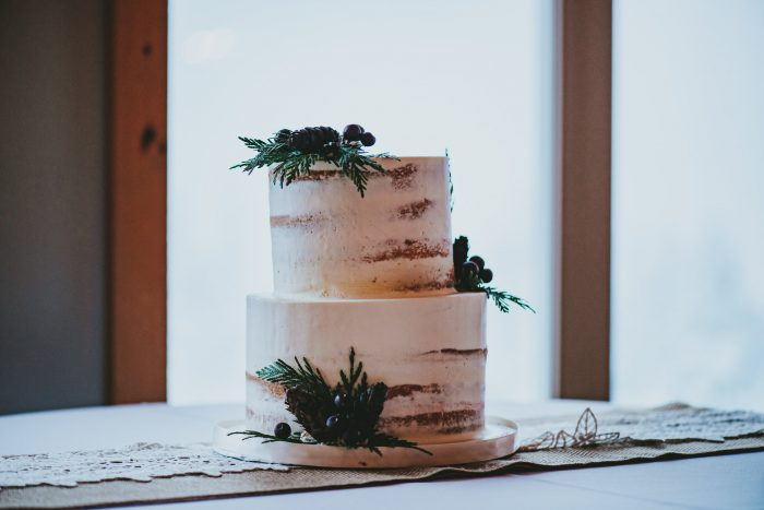 A photo of a rustic style cake at a rustic wedding.