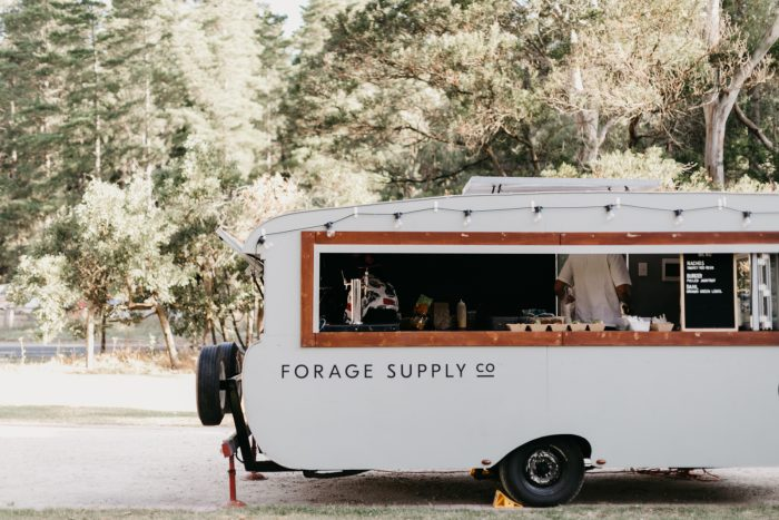 A photo of a food truck catering at a boho style wedding.