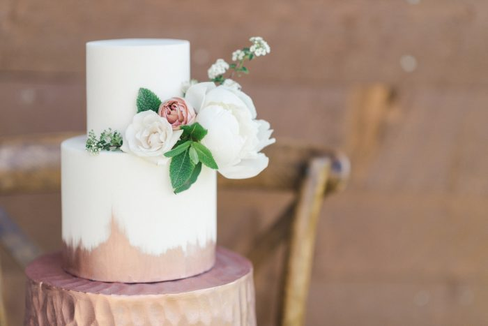A close-up photo of a country style wedding cake.