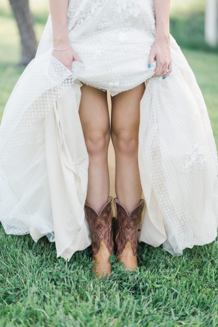 A photo of a bride wearing cowboy boots for her wedding.