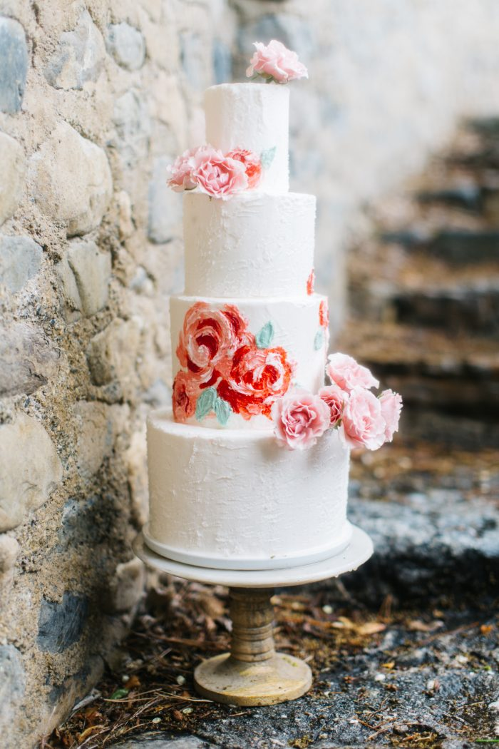 A photo of a romantic style cake at a romantic wedding.
