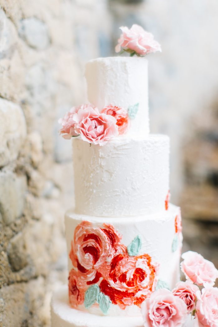 A close-up photo of a romantic style cake.