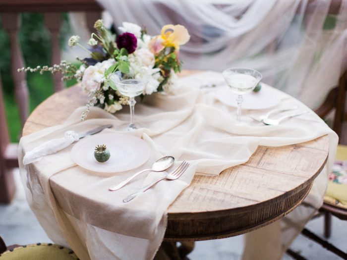 A close-up photo of a vintage style table at a vintage style wedding.