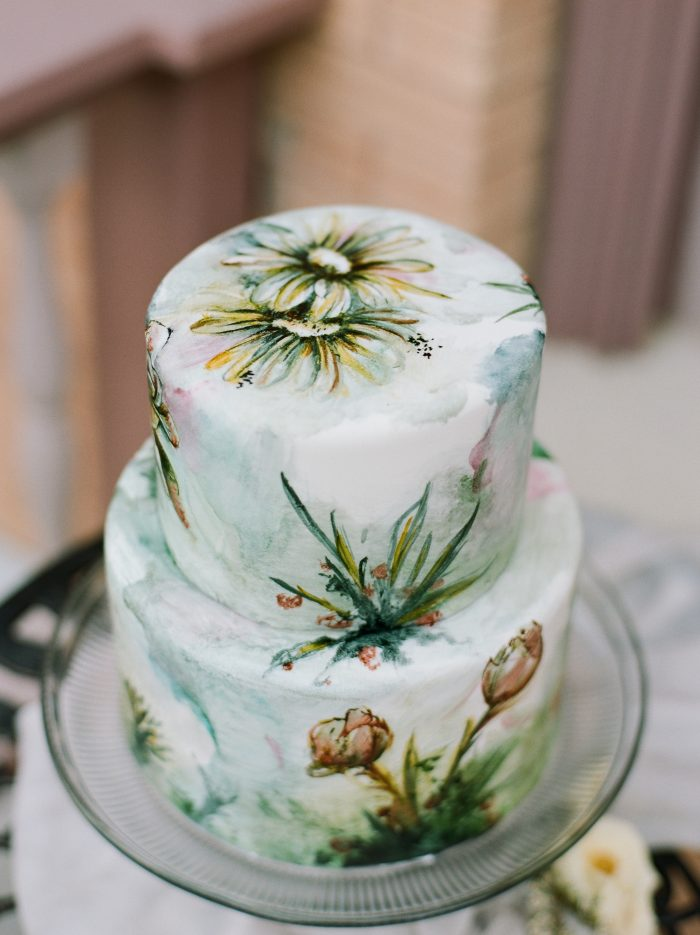 A photo of a vintage style cake at a vintage style wedding.