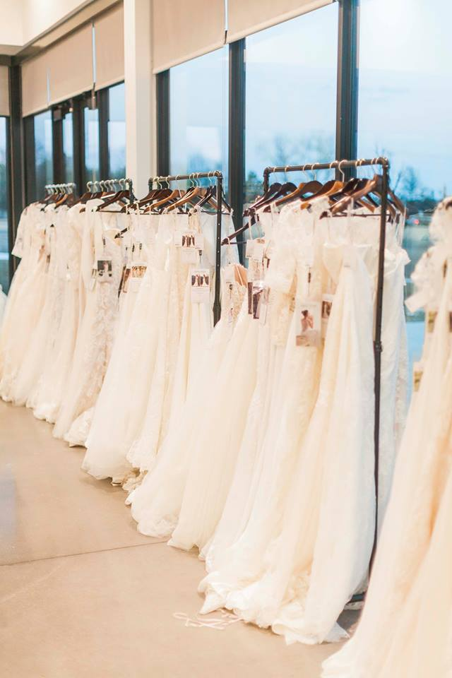 Dress racks filled with Maggie Sottero and Sottero and Midgley gowns