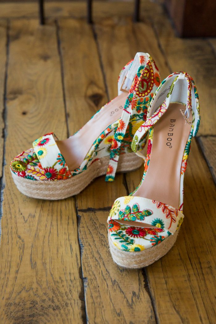 Colorful florals and white high heels