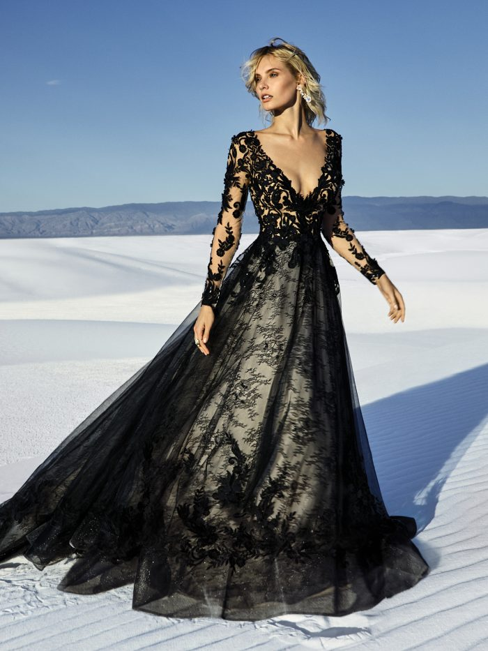 Model Wearing Black Long Sleeve Lace Wedding Gown Called Zander by Sottero and Midgley