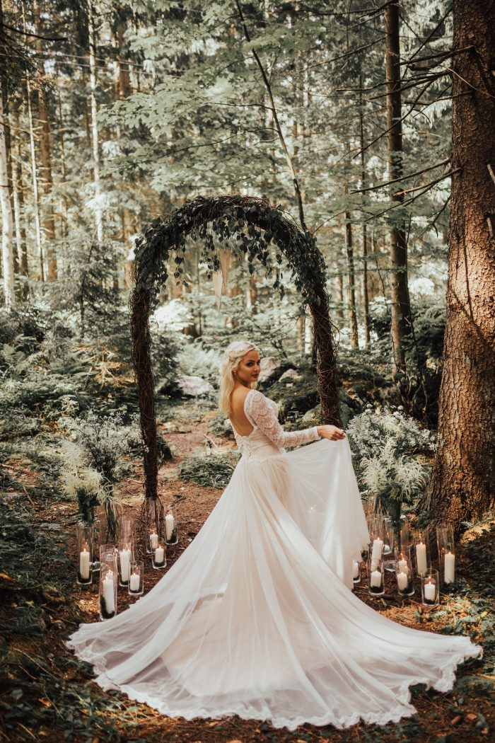Couple in Forest with Bride Wearing Boho Wedding Gown Called Deirdre by Maggie Sottero