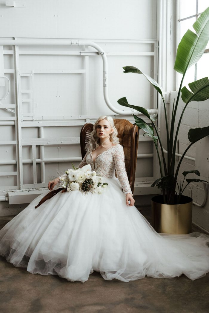 Model Wearing Scalloped Ball Gown Wedding Dress Called Mallory Dawn by Maggie Sottero