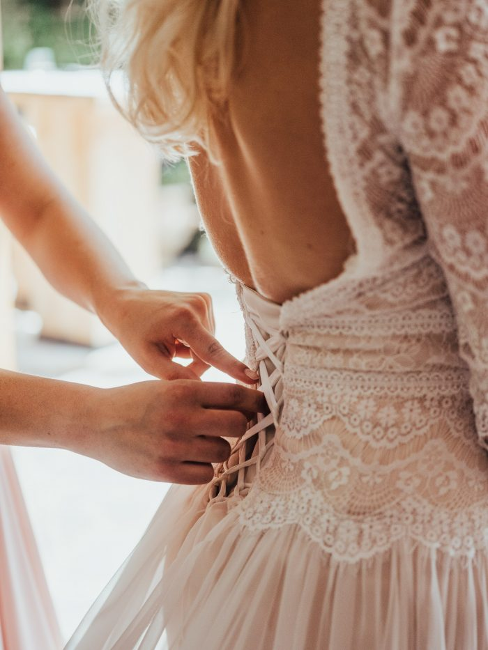Deirdre Wedding Dress by Maggie Sottero being laced up