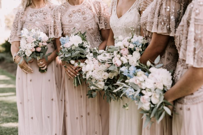 Vintage blush wedding dresses with Bride wearing vintage beaded Ettia Wedding Dress by Maggie Sottero