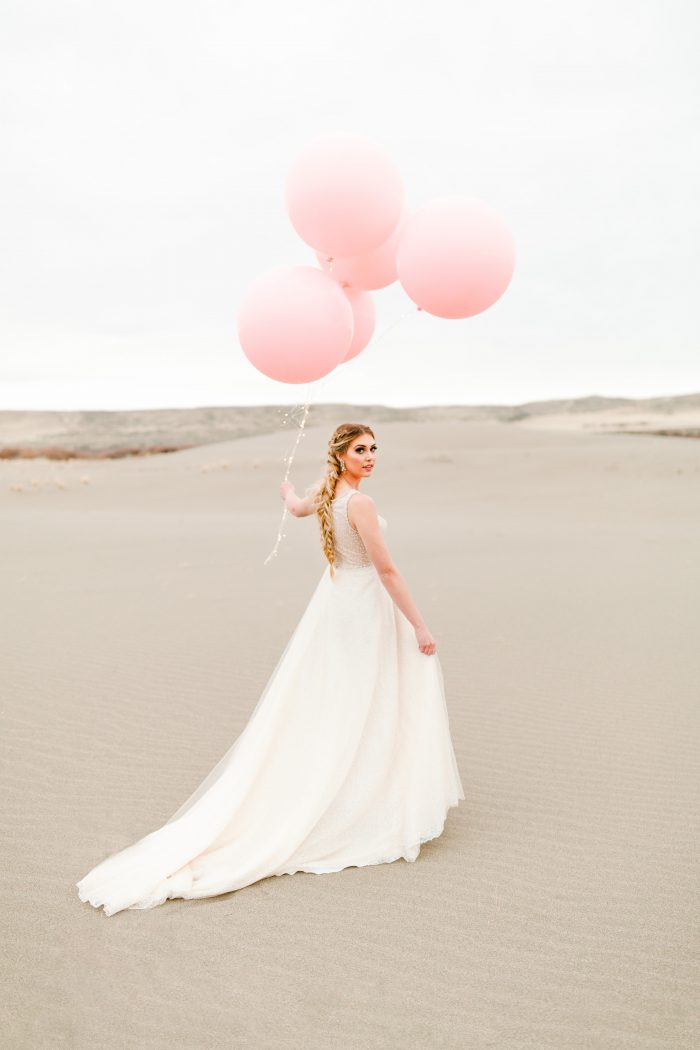Bride wearing beaded sheath wedding dress Jarret by Sottero and Midgley