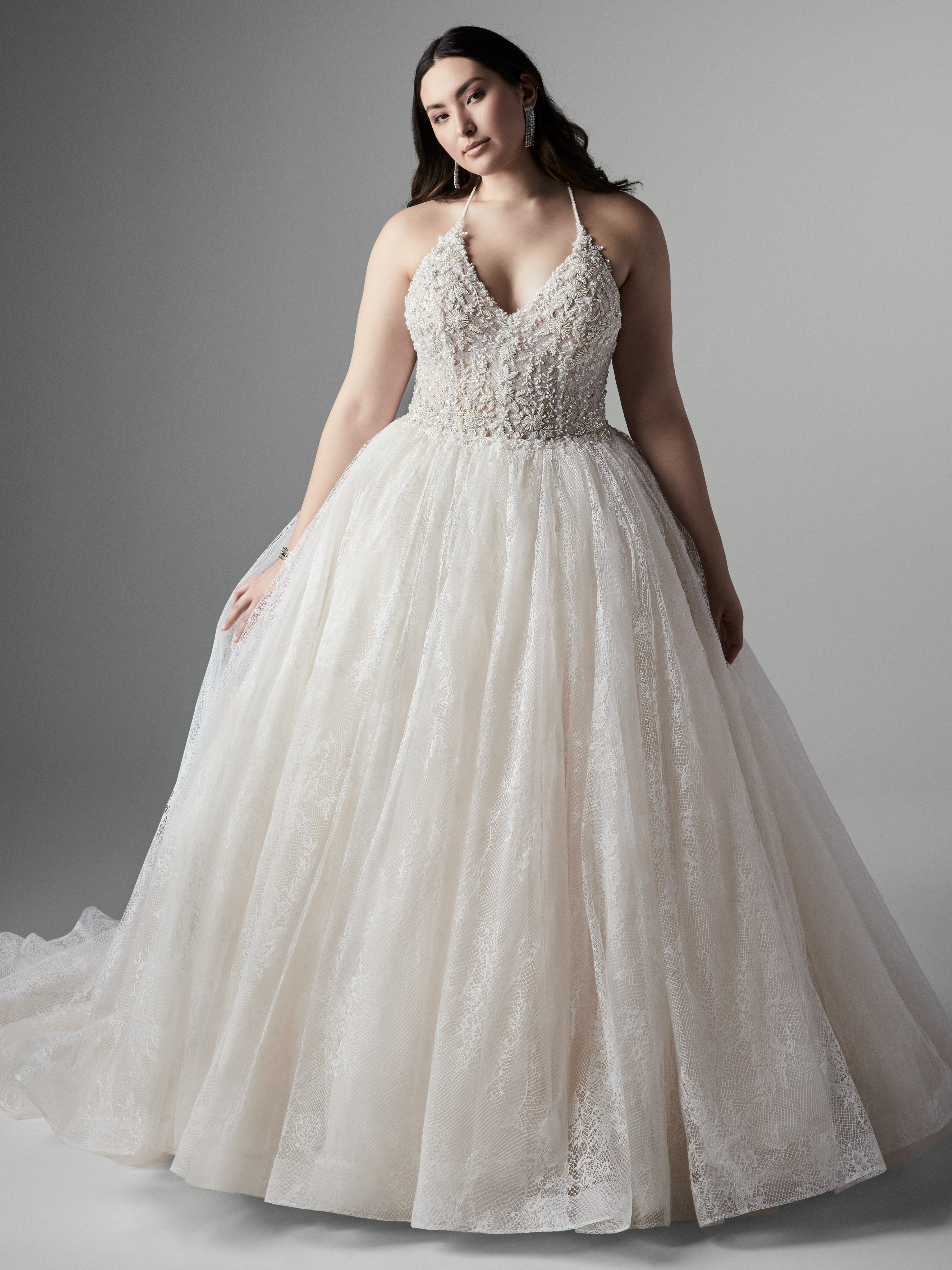 Model Wearing Plus Size Halter Neck Ball Gown Called Thaddeus by Sottero and Midgley
