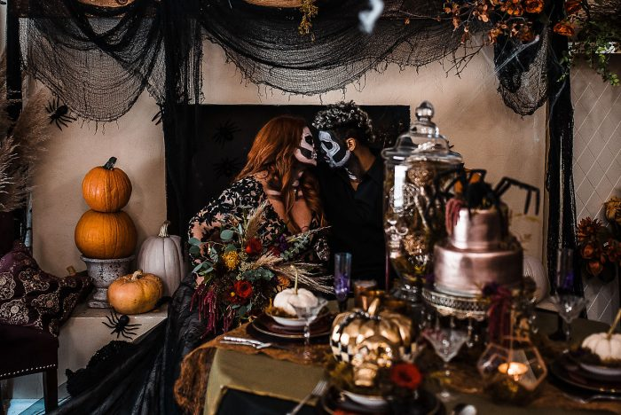 Halloween themed wedding decor with bride wearing Zander black wedding dress by Sottero and Midgley