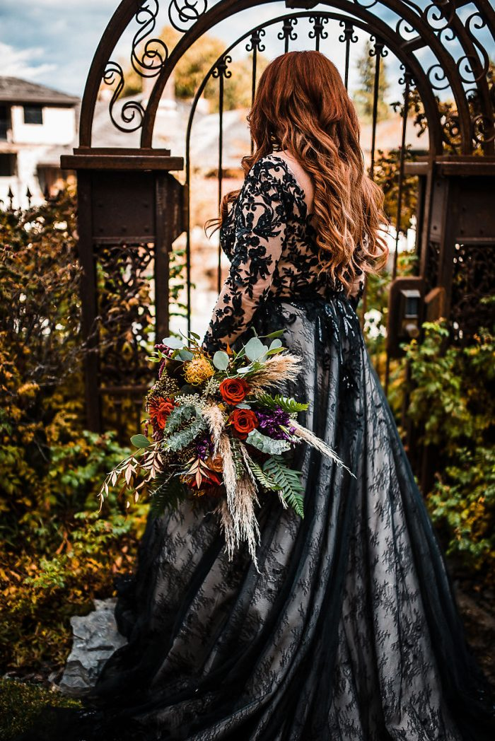 Real Bride Wearing Black Wedding Dress by Maggie Sottero and Fall Wedding Bouquet