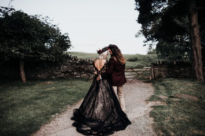 Gothic Bride Wearing Zander Halloween Wedding Dress by Sottero and Midgley with Groom Wearing Maroon Suit Coat