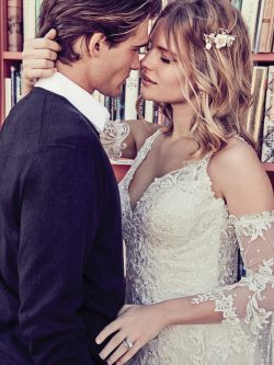 Groom Kissing Bride Wearing Lucienne Wedding Dress by Maggie Sottero