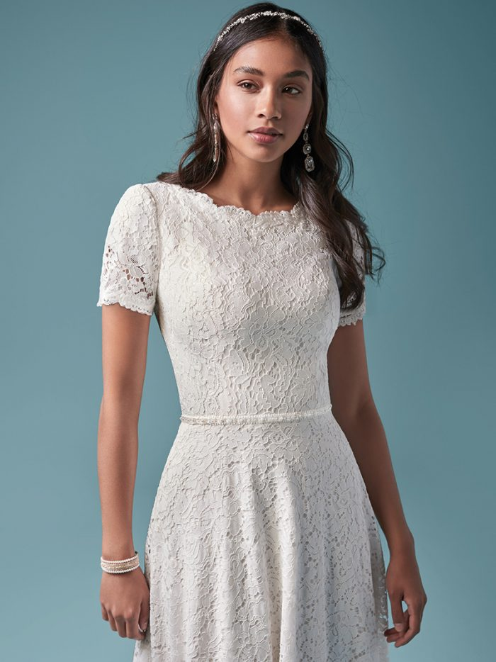 Model Wearing Modest Lace A-line Wedding Dress Called Prescott by Maggie Sottero