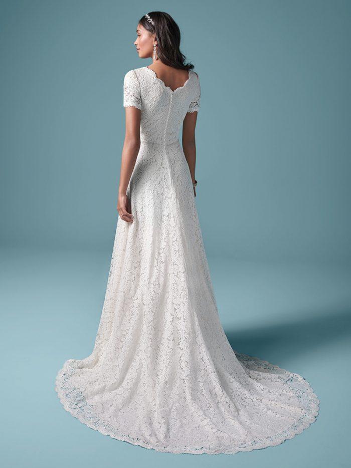 Model Wearing Modest Cap-sleeve A-line Wedding Dress Called Prescott by Maggie Sottero