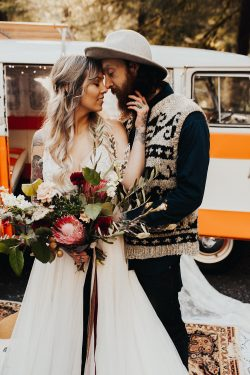 Groom with Bride Wearing Boho Wedding Dress Called Charlene by Maggie Sottero