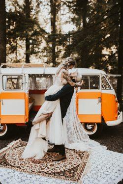 Groom Picking Up Bride Wearing Boho Wedding Dress Called Charlene by Maggie Sottero