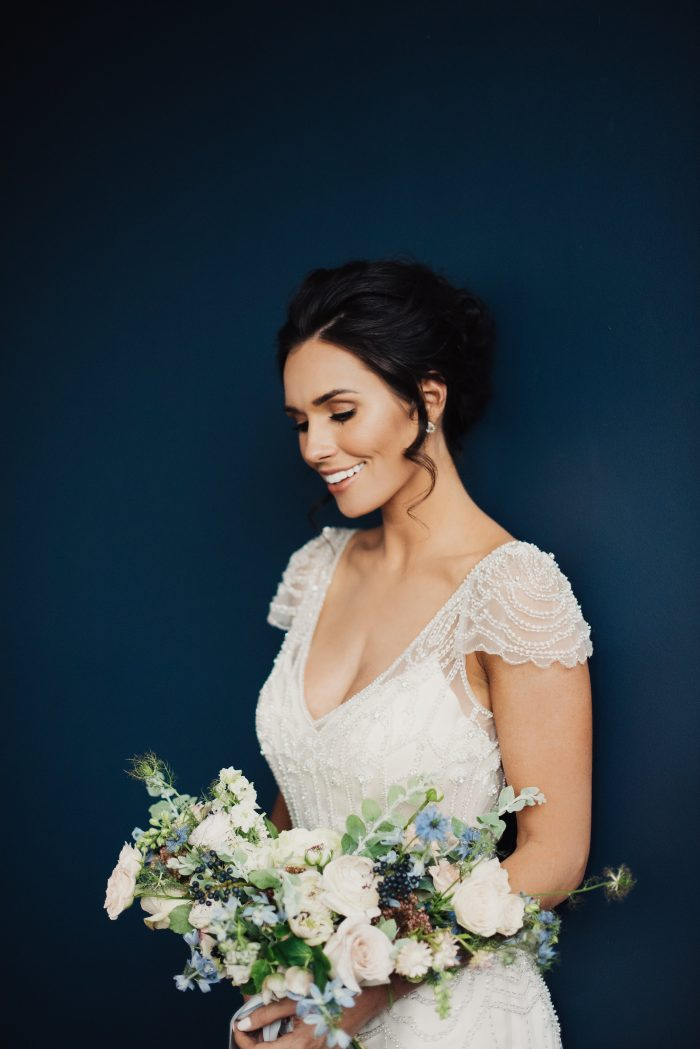 Bride Wearing Vintage Wedding Dress Called Ettia by Maggie Sottero with Blue and Blush Bouqet