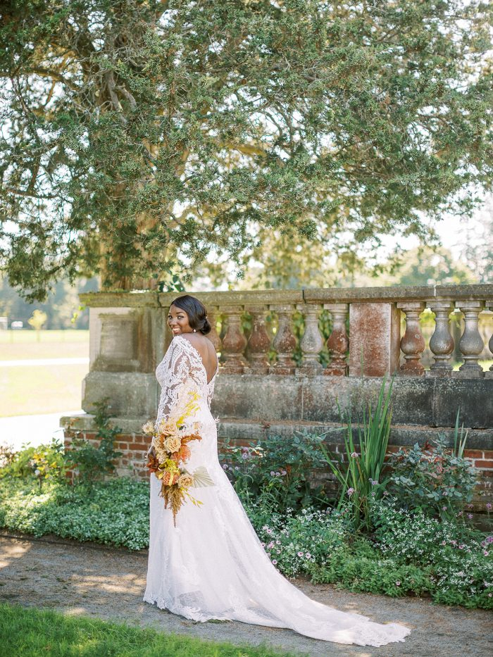 Bride from Back Wearing Long Sleeve Boho Wedding Dress Called Cheyenne by Maggie Sottero