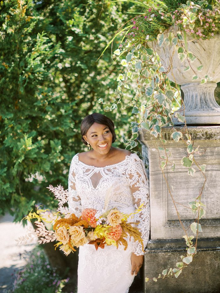 Bride Smiling Wearing Long Sleeve Boho Wedding Dress Called Cheyenne by Maggie Sottero