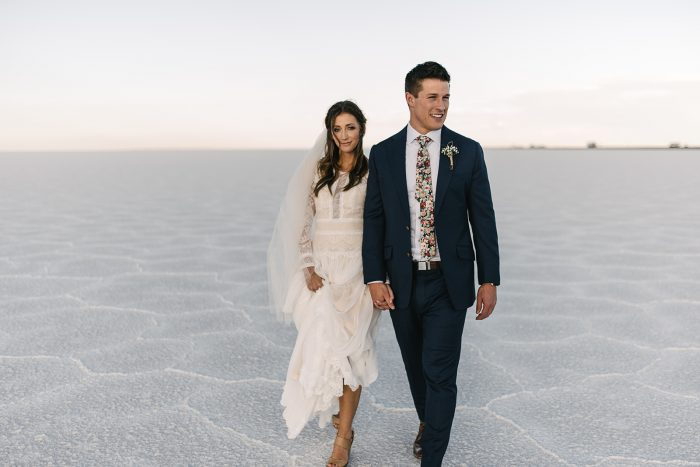 Groom with Real Bride at Salt Flats Wearing Lace Long Sleeve Winter Wedding Dress Deirdre by Maggie Sottero