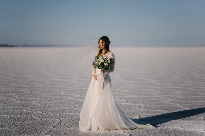Bride on the salt flats wearing Dierdre by Maggie Sottero