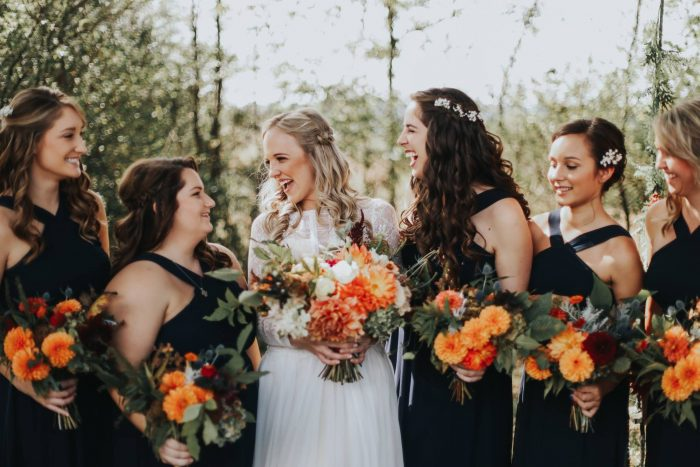 Brides and Bridesmaids with Bride wearing Deirdre by Maggie Sottero