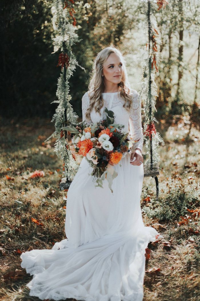 Real Bride on Swing Wearing Lace Chiffon Wedding Dress Called Deirdre by Maggie Sottero