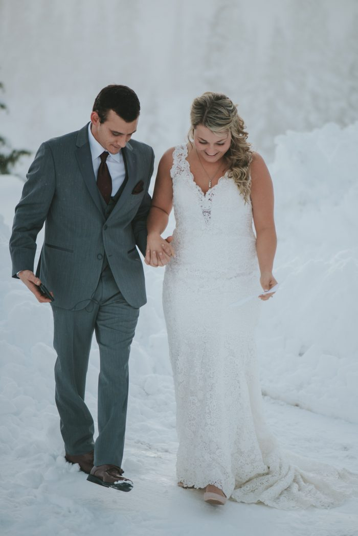 Groom with Real Bride in Snow Wearing Lace Wedding Dress Called Hope by Rebecca Ingram