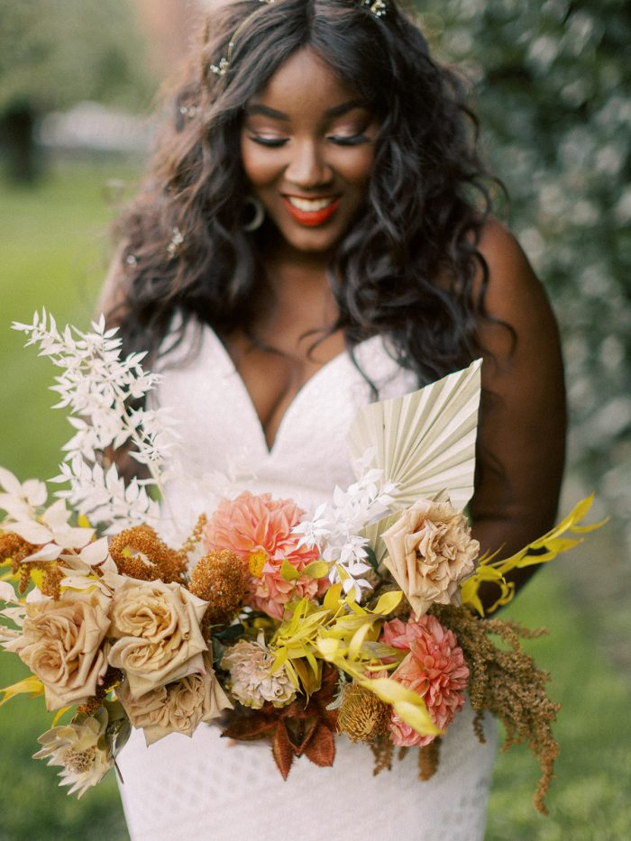 Bride with Bouquet Wearing Boho Bridal Gown Called Lilana by Maggie Sottero