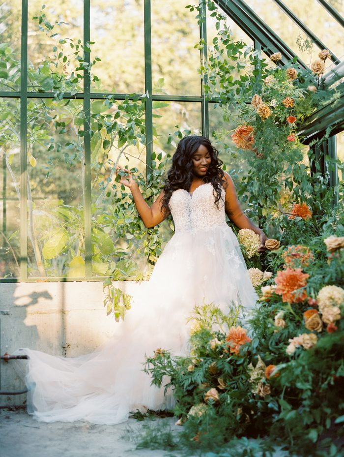 Bride in Greenhouse Wearing Lace Bodice Wedding Dress Called Marisol by Rebecca Ingram