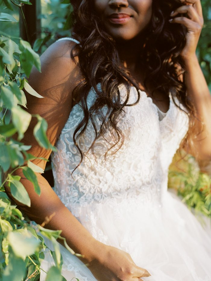 Close Up of Bride Wearing Lace Bodice A-line Wedding Gown Called Marisol by Rebecca Ingram