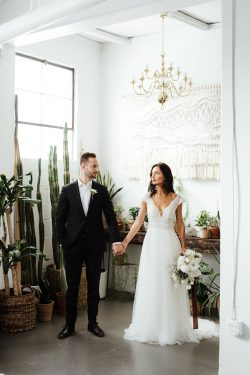 Real Couple Holding Hands and Bride Wearing Boho Cap-Sleeve Wedding Dress Called Monarch by Maggie Sottero