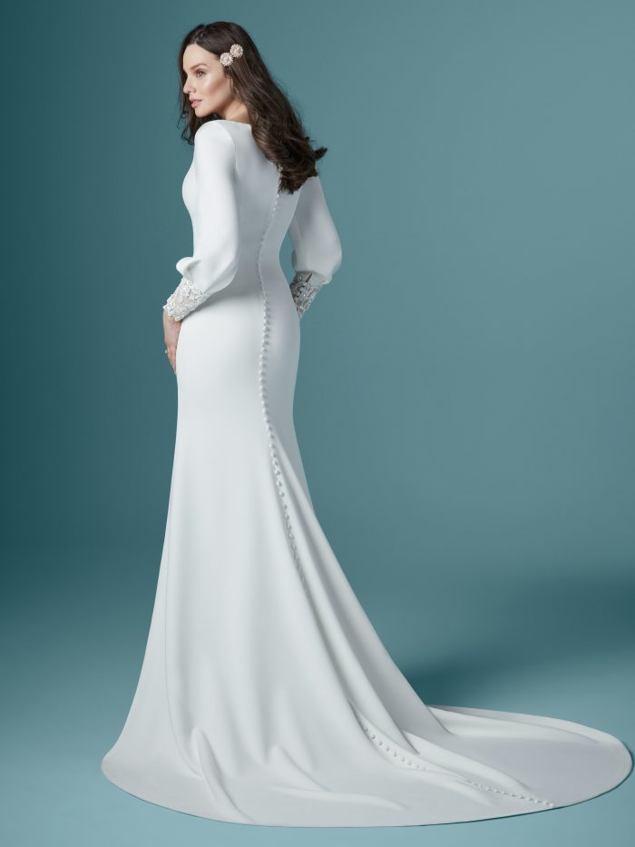Model From Back Wearing Bishop Sleeve Crepe Wedding Gown by Maggie Sottero