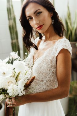 Real Bride with Flowers Wearing Boho Cap-Sleeve Bridal Gown Called Monarch by Maggie Sottero